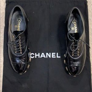 Chanel black platform with gold camellia details